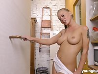 Darina Nikitina masturbates alone using her hand and red dildo