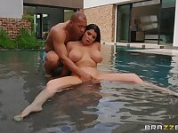 Busty and tattooed Romi Rain likes to fuck with a stranger in the pool